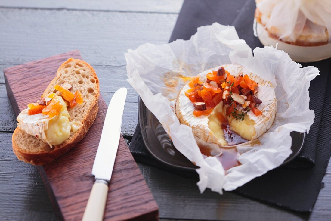 Baked Camembert with dried fruits and nuts