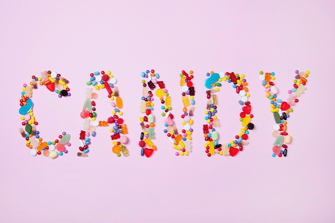 Colourful sweets spelling the word CANDY