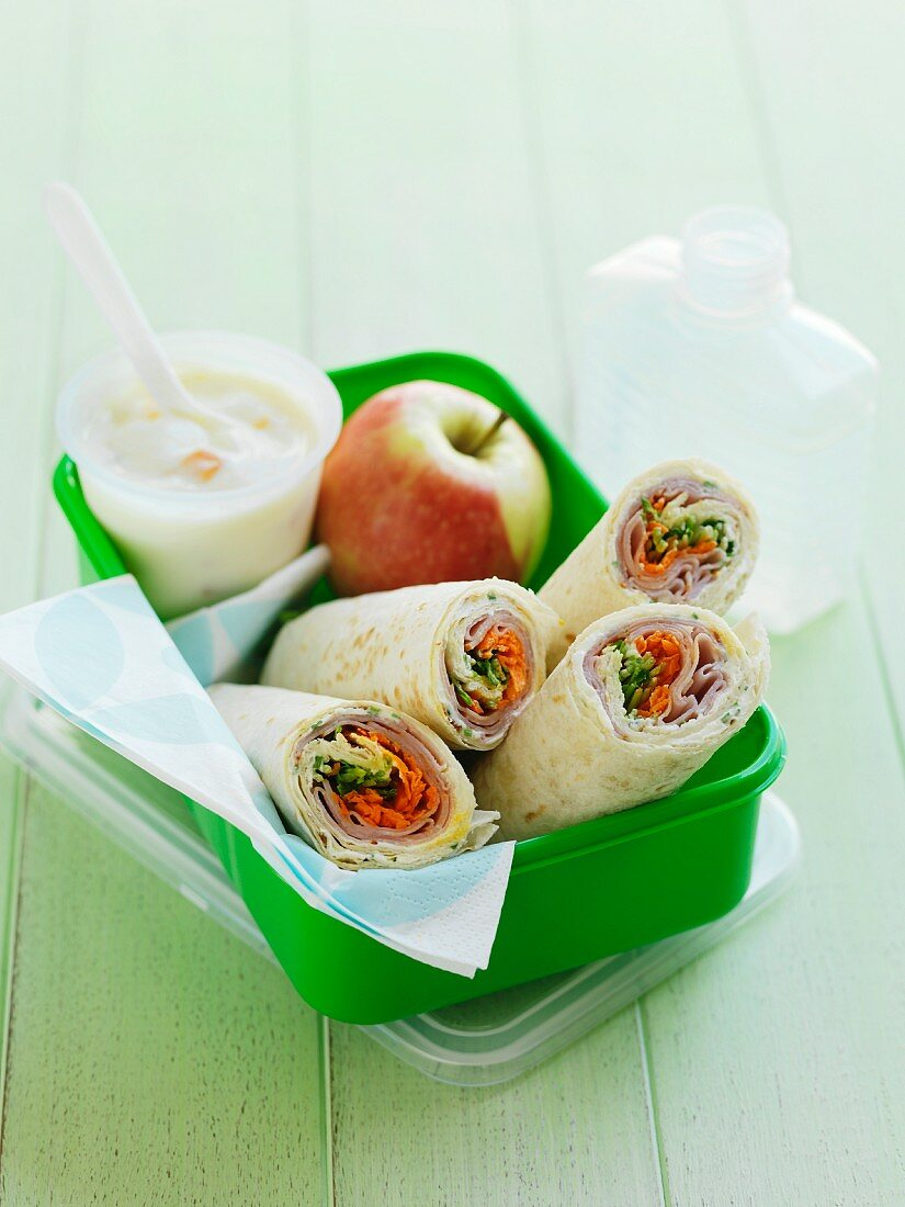 Wraps, apple and yoghurt in lunch box