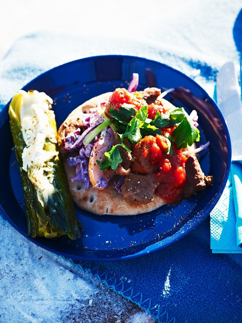 Stuff leek and unleavened bread with sausages and tomatoes for a winter picnic