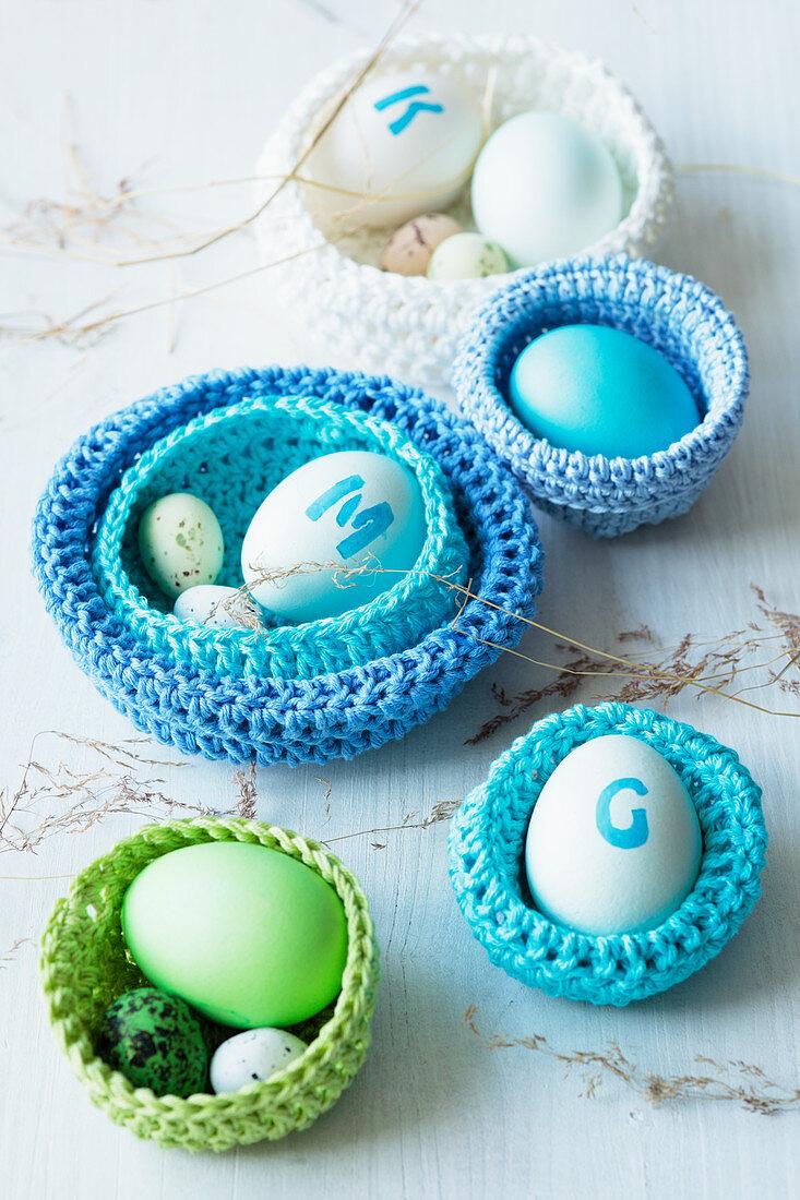 Easter eggs in crocheted baskets
