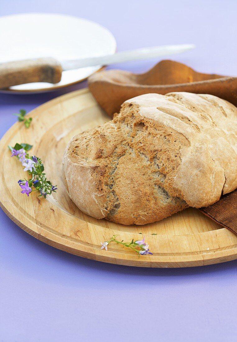 Three grain bread on a wooden plate