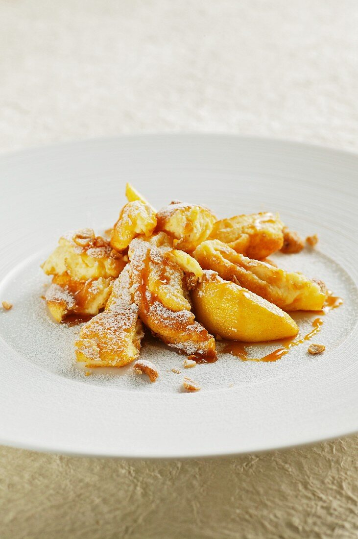Kaiserschmarren (shredded sugared pancake from Austria) with caramelised apples