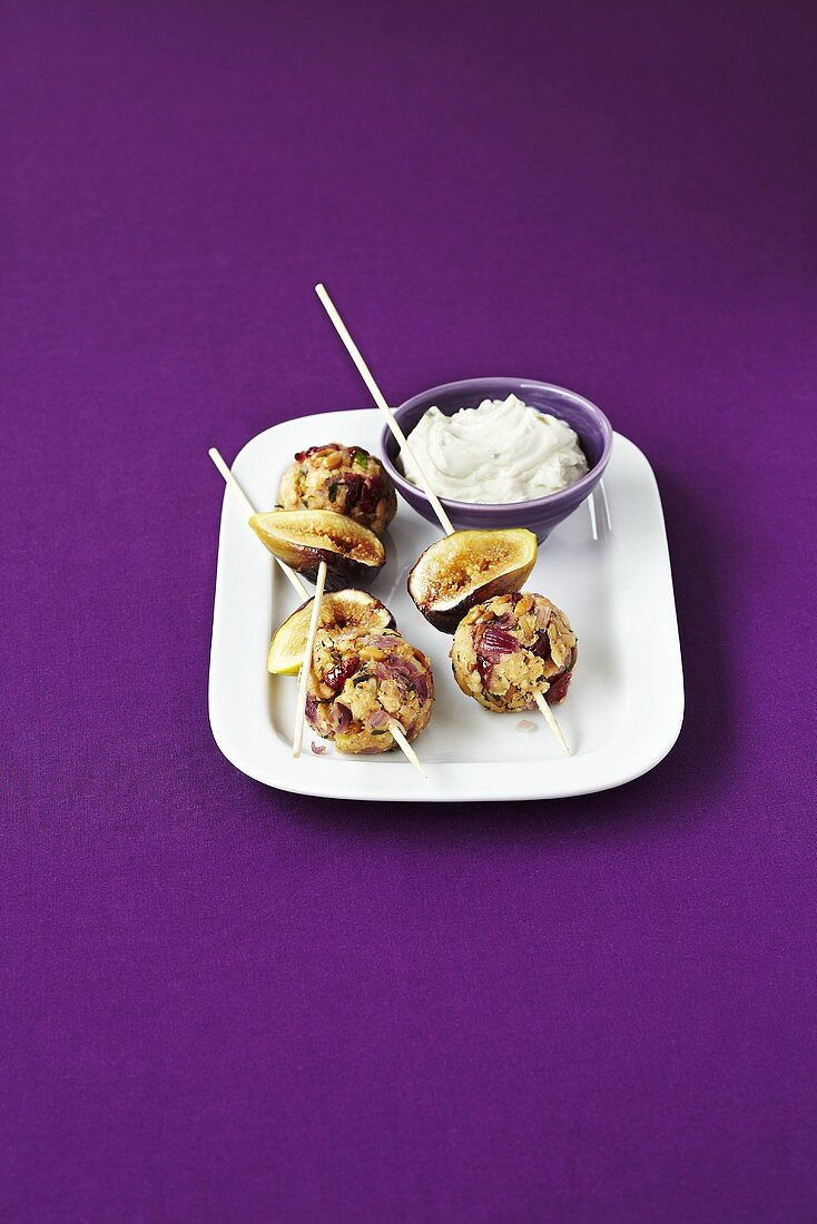Figs and onion-nut balls on skewers