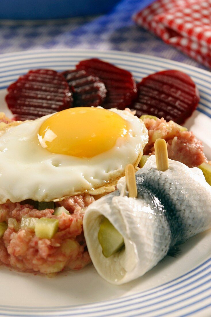 Lobscouse with soused herring and a fried egg (Germany)