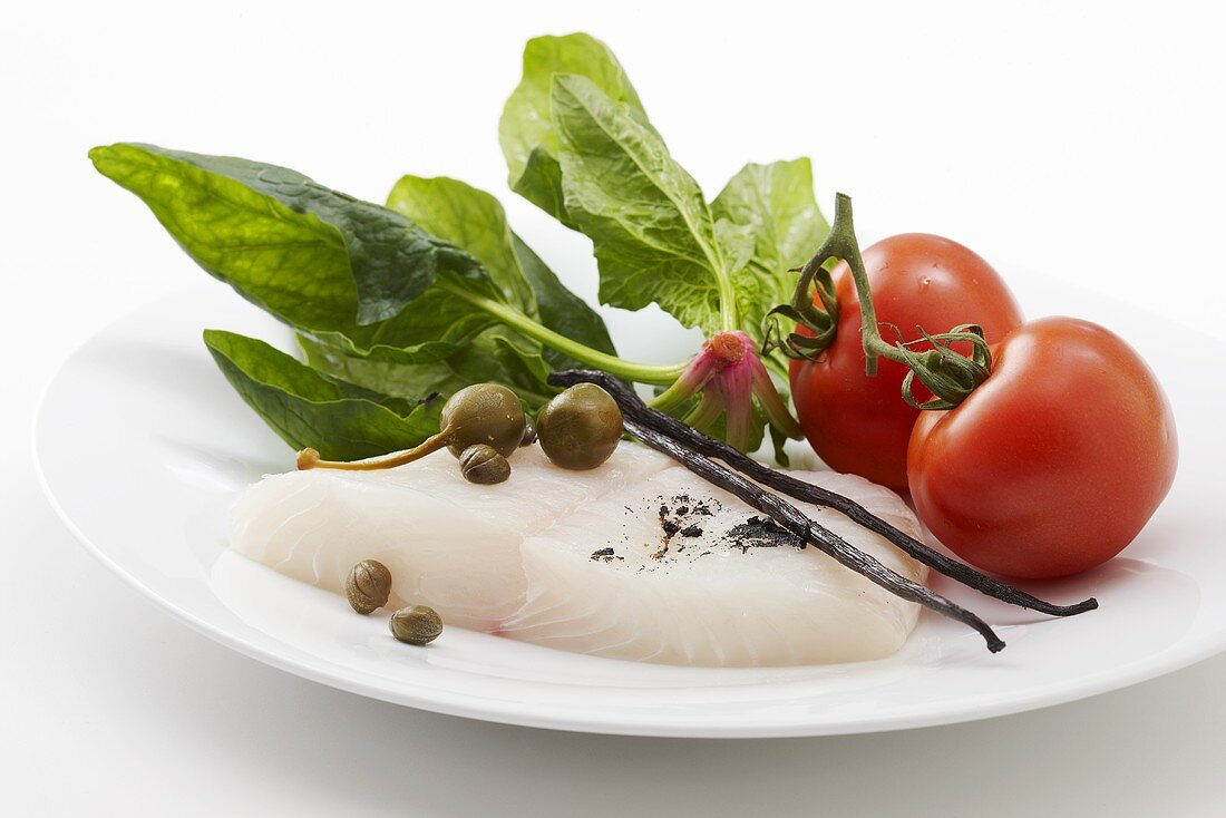 Halibut, spinach, capers, vanilla pods and tomatoes