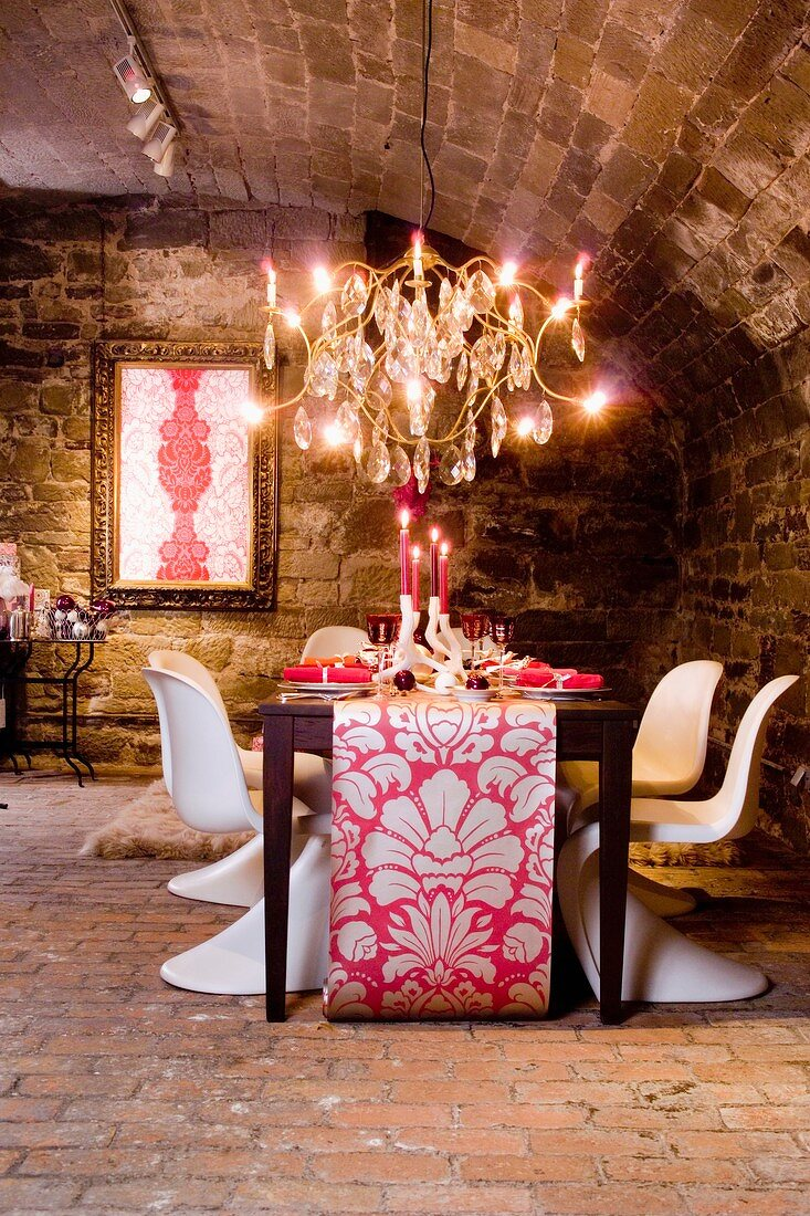 A festively laid table for Christmas dinner in a vaulted cellar