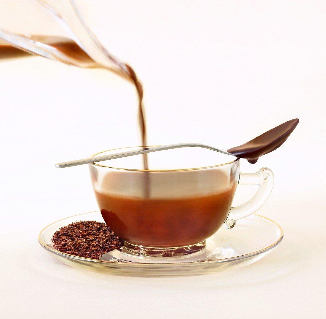 Cocoa Infused Tea; Chocolate Infused Rooibos Tea with Loose Tea Leaves on Saucer; Chocolate Spoon