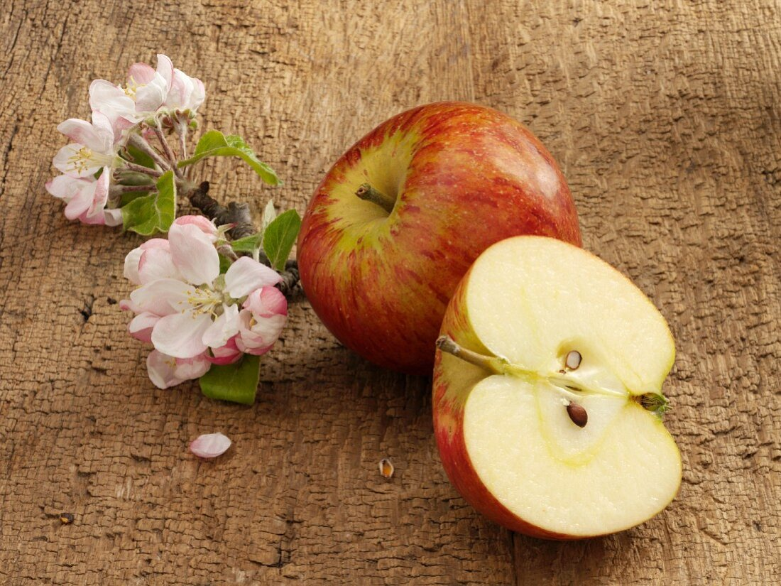An apple, apple blossoms and half an apple