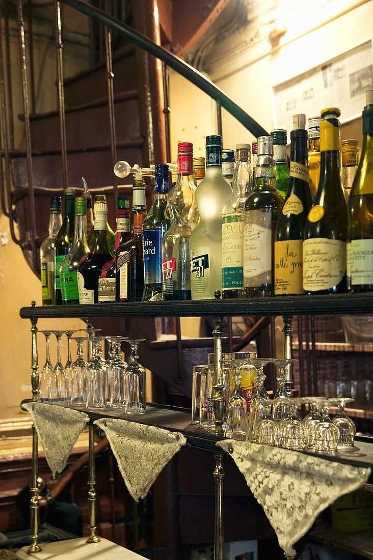 Various drinks in bottles and glasses in a bar