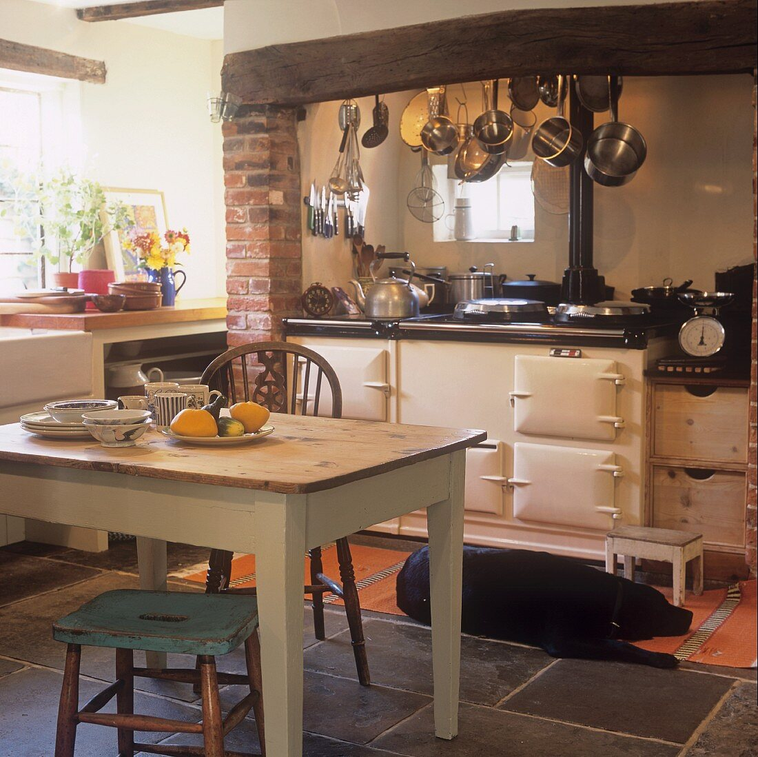 A rustic kitchen with a wood-fired oven