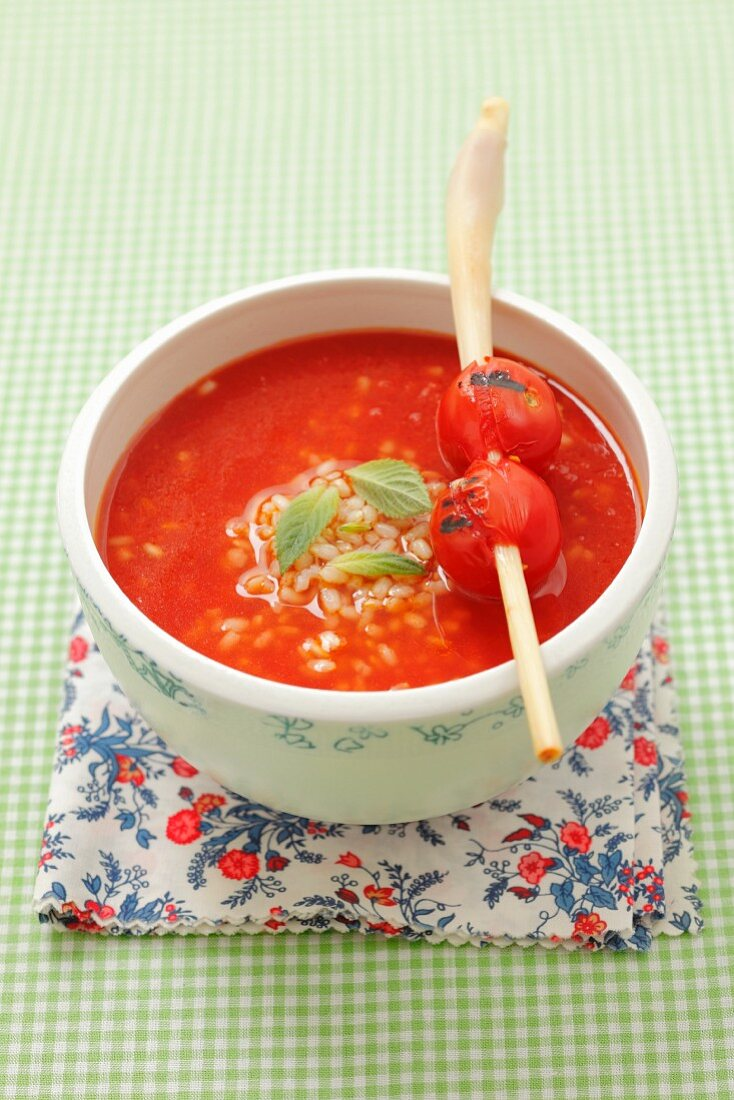 Cream of tomato soup with rice, lemongrass, cherry tomatoes and mint