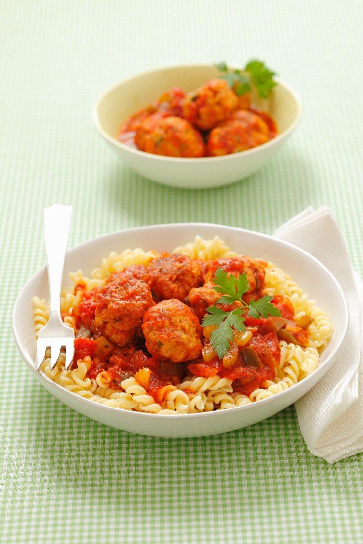Fusilli pasta with chicken dumplings and tomato sauce