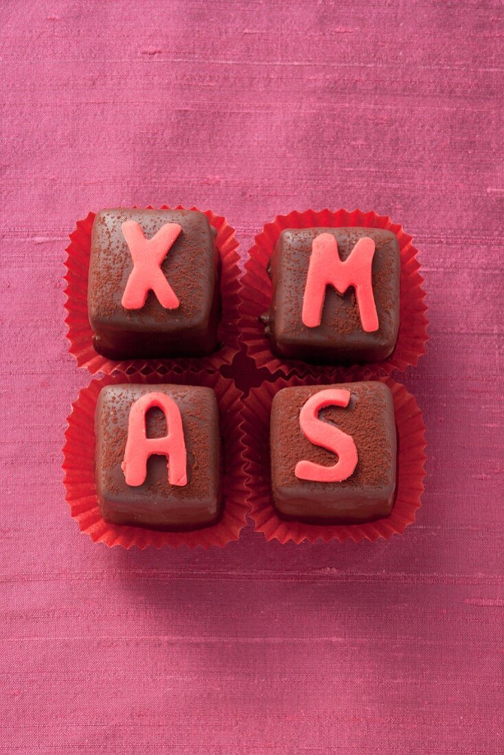 Christmas pralines decorated with letters
