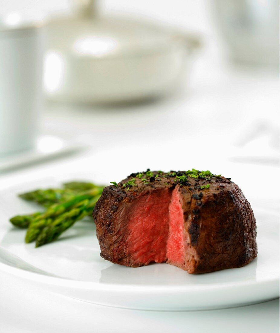 Beef Filet Cooked Rare with Slice Removed; Served with Asparagus