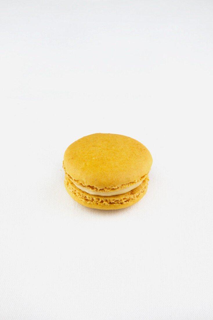 A Single Lemon Macaroon on a White Background