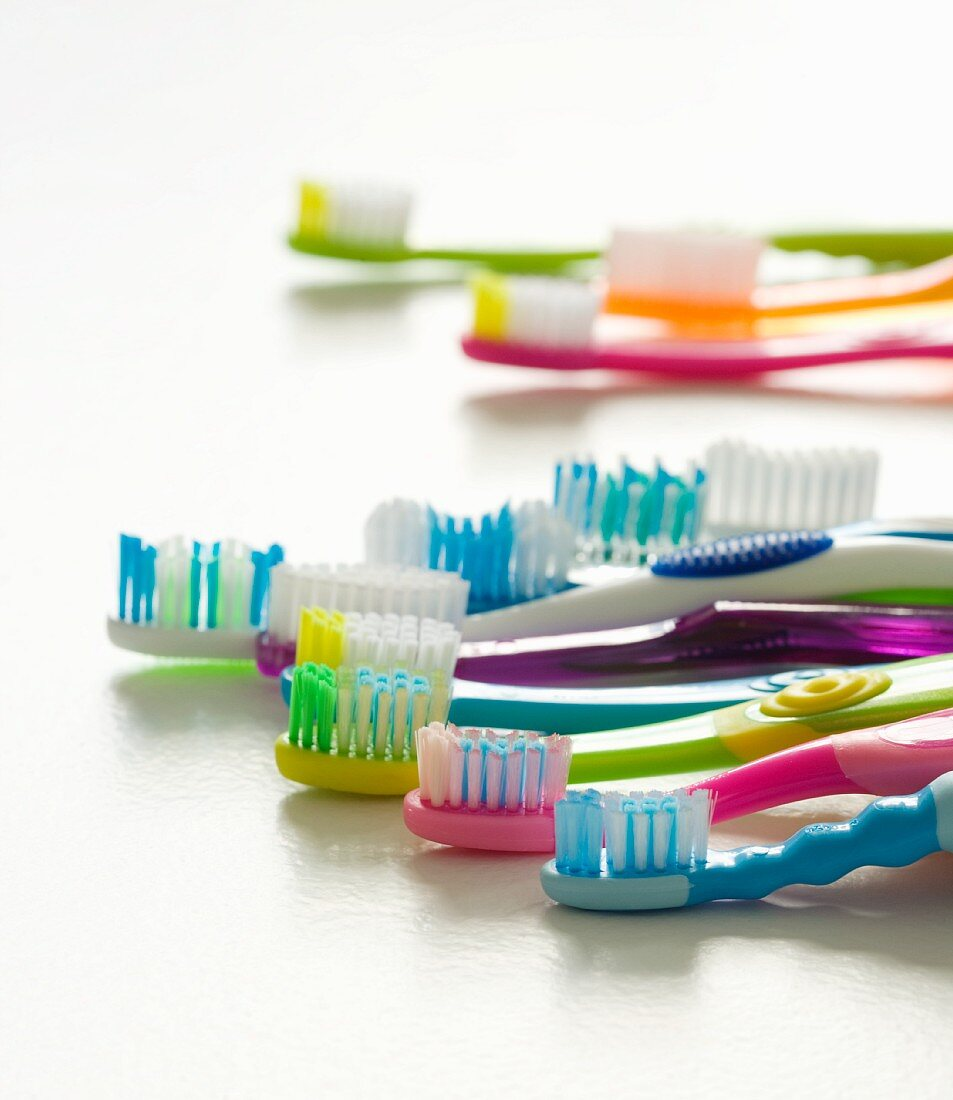 Assorted Colorful Toothbrushes on White