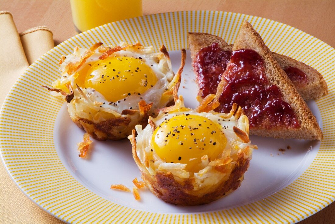 Eggs in Hash Brown Baskets with Toast with Jelly