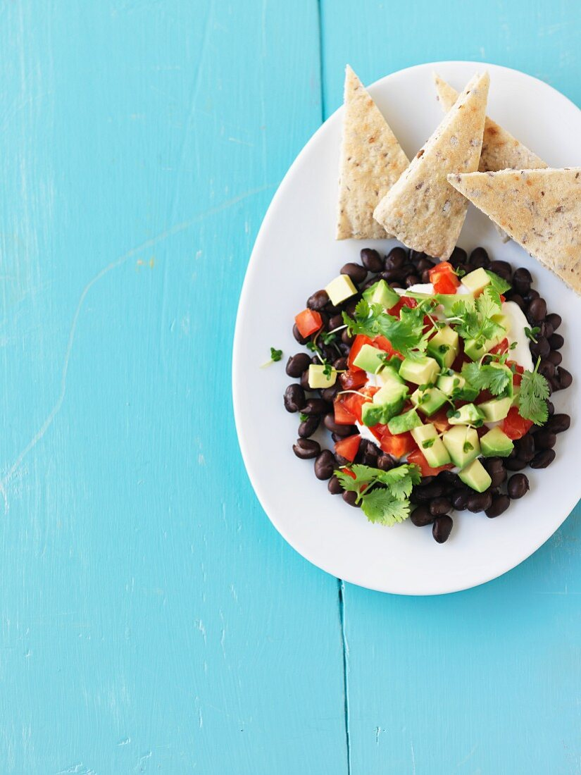 Bean and avocado dip with unleavened bread