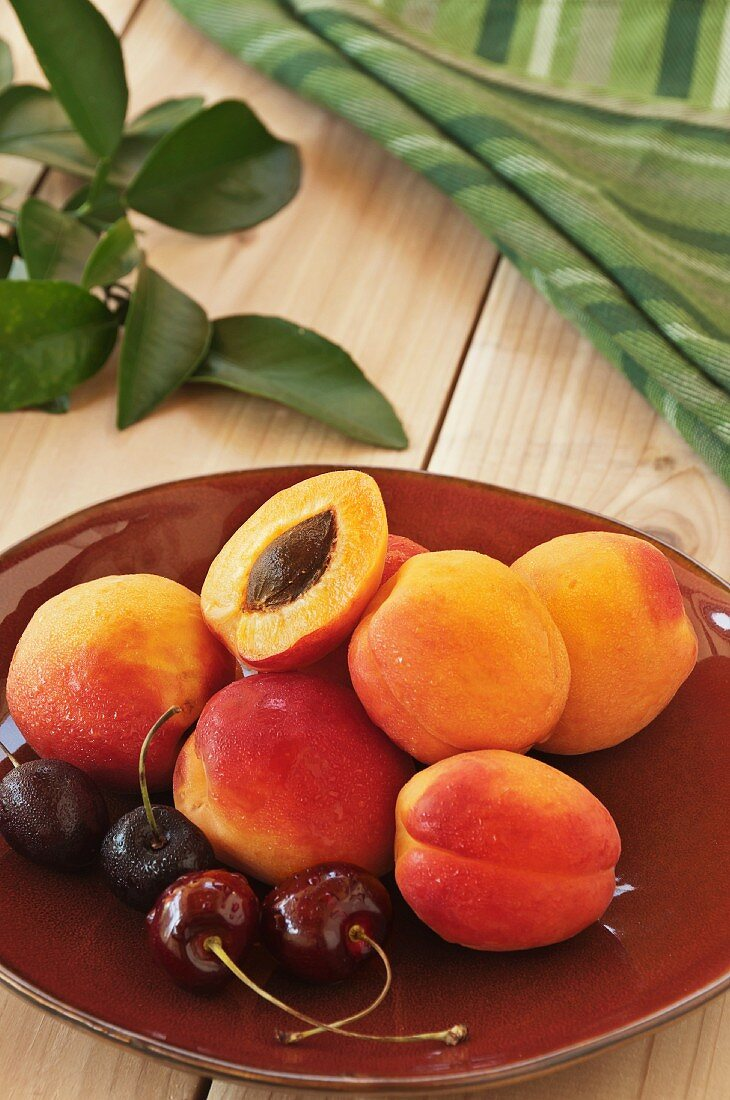 Fresh Apricots and Cherries on a Plate