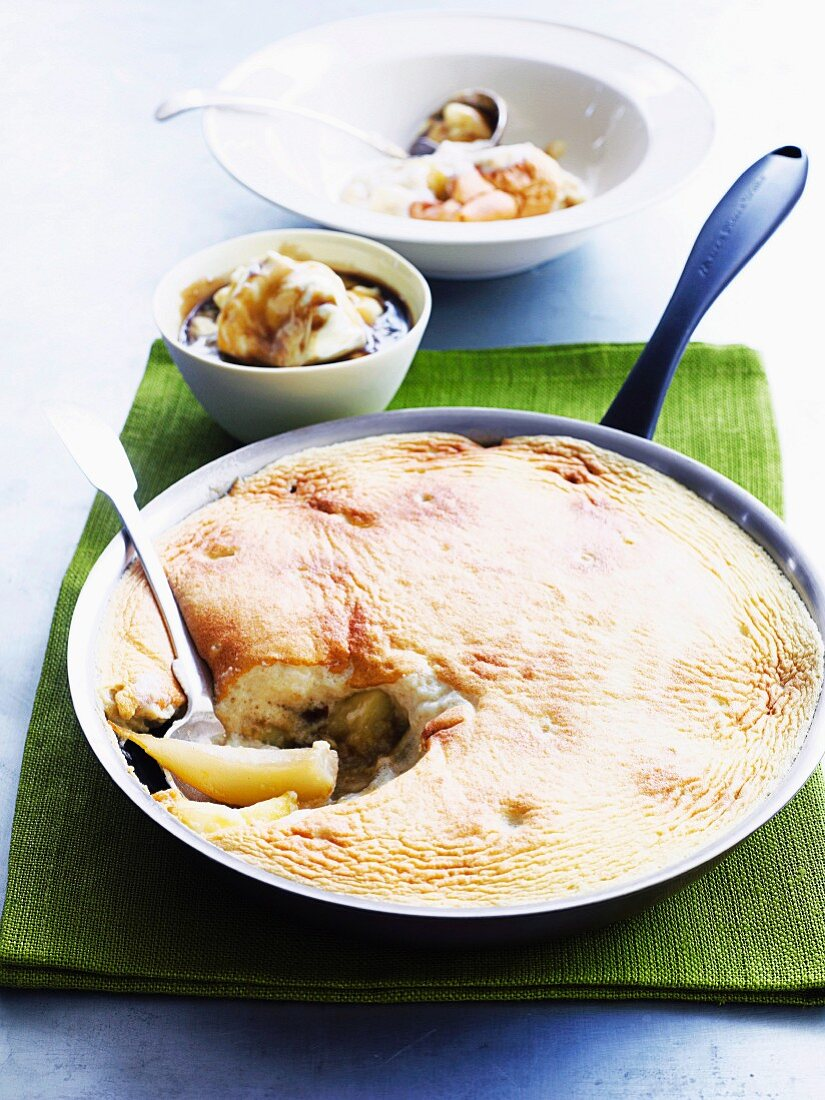 Pear and apple soufflé with cinnamon in a pan