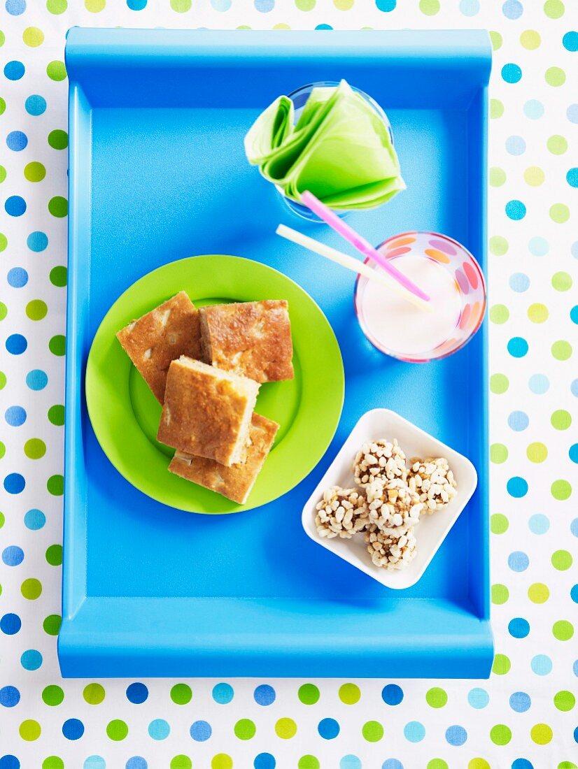 Pineapple cake, crispy fruit bowls with puffed rice and a milkshake