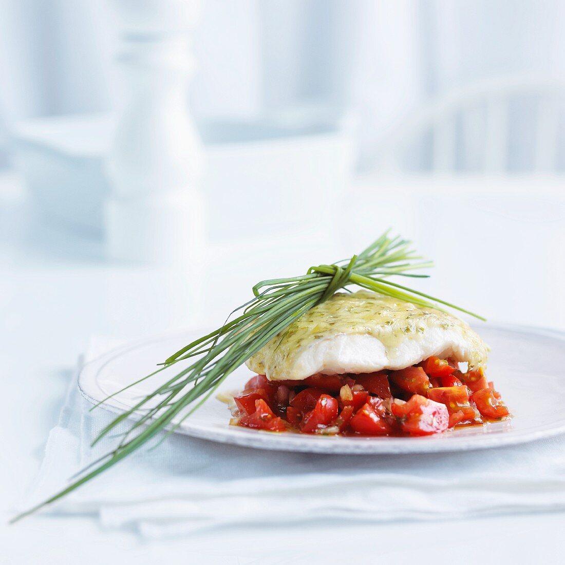 Cod au gratin on a bed on tomato salsa
