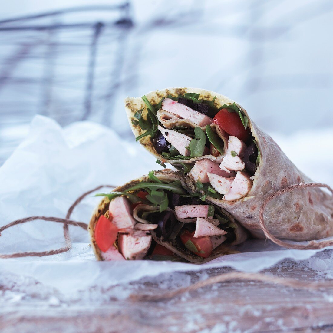 Chicken wraps with rocket, olive and tomatoes