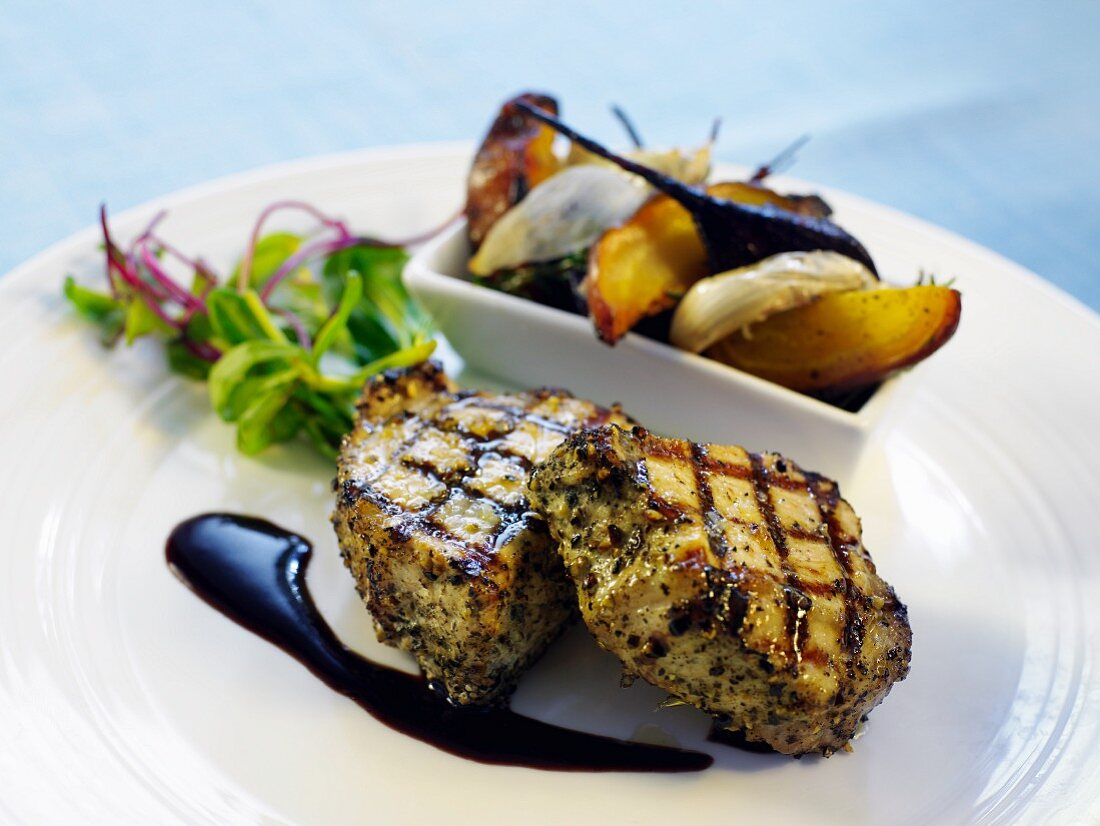 Grilled chops with vegetables and salad