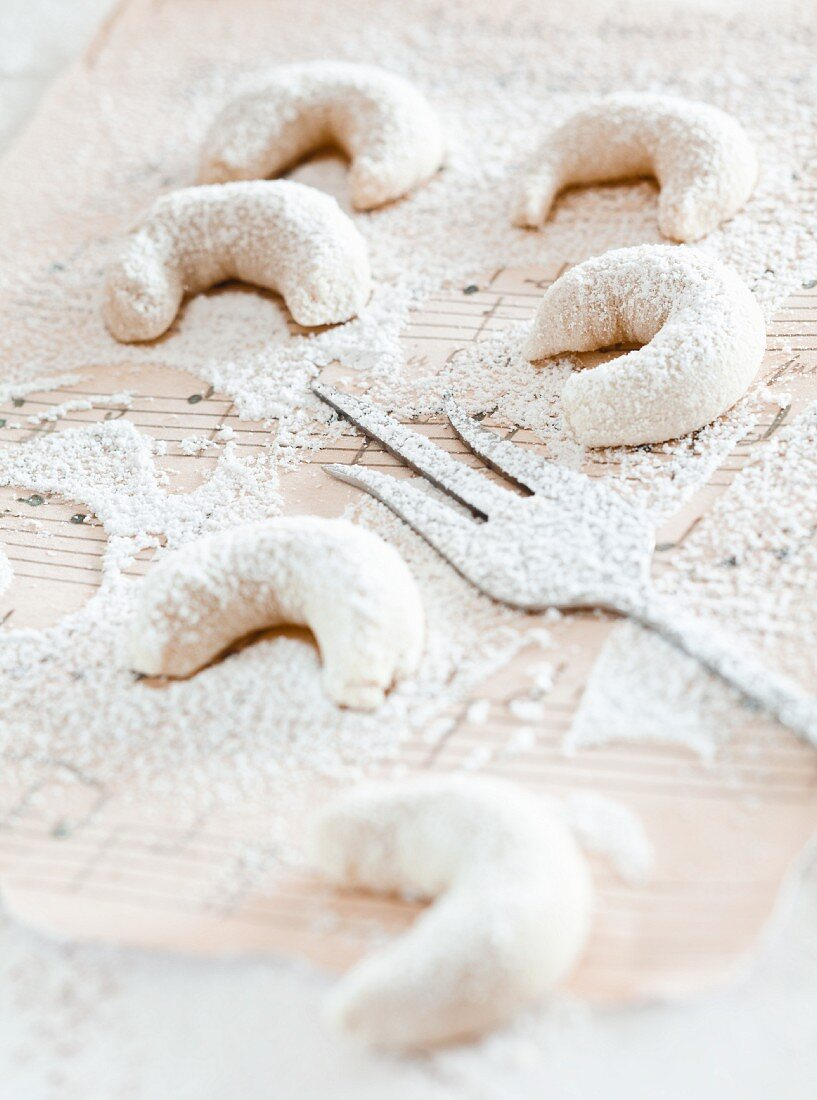 Vanilla crescent biscuits on a page of sheet music