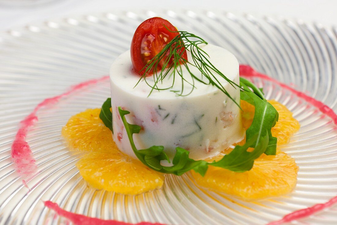 Cream cheese mousse on thinly sliced orange with dill