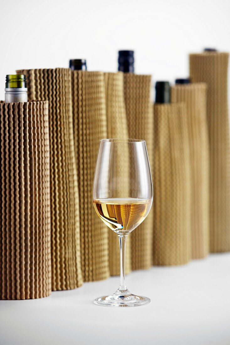 Blind wine tasting: concealed wine bottle and white wine glass