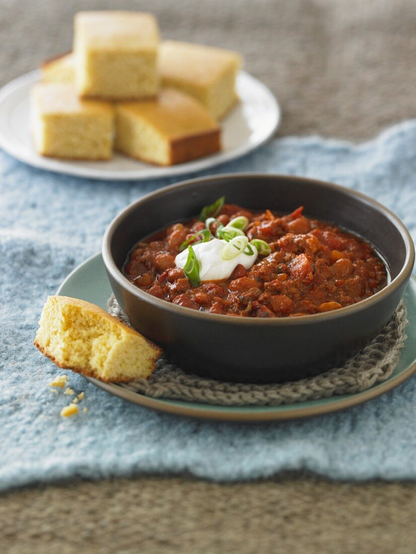 Bowl of Chilli with a Dollop of Sour Cream; With Corn Bread
