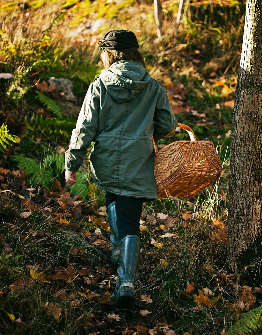 A woman with a basket in a forest