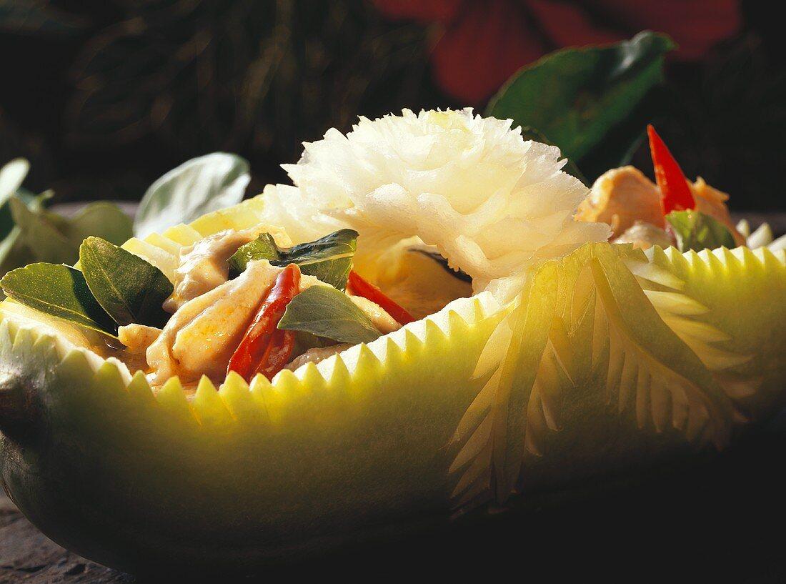 Chicken Stir Fry in a Decoratively Cut Melon Bowl