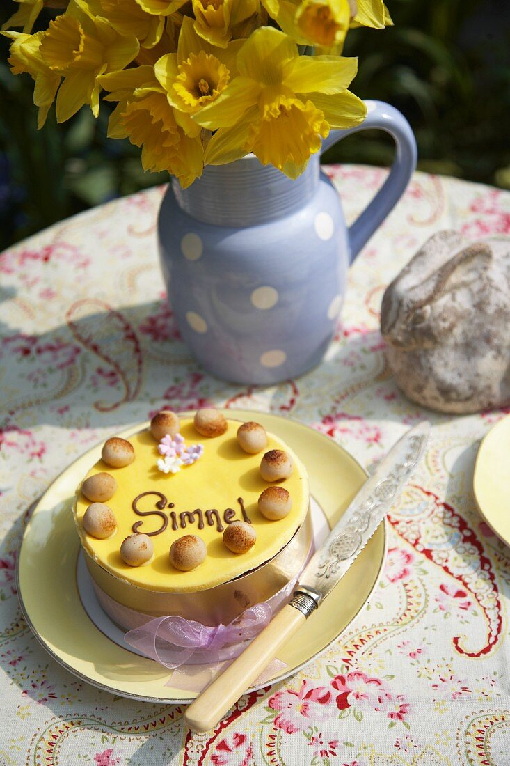 A simnel cake (English Easter cake) on a table in the garden