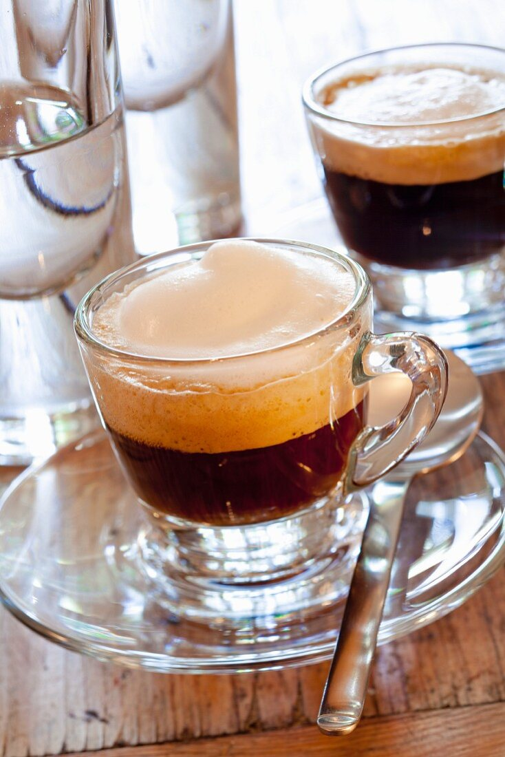 A cup of espresso with milk froth