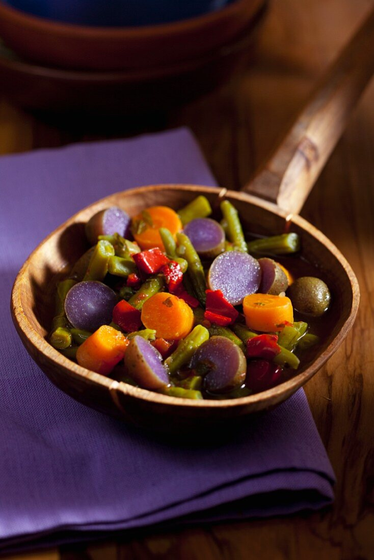 Vegetable casserole with bean, purple potatoes and carrots