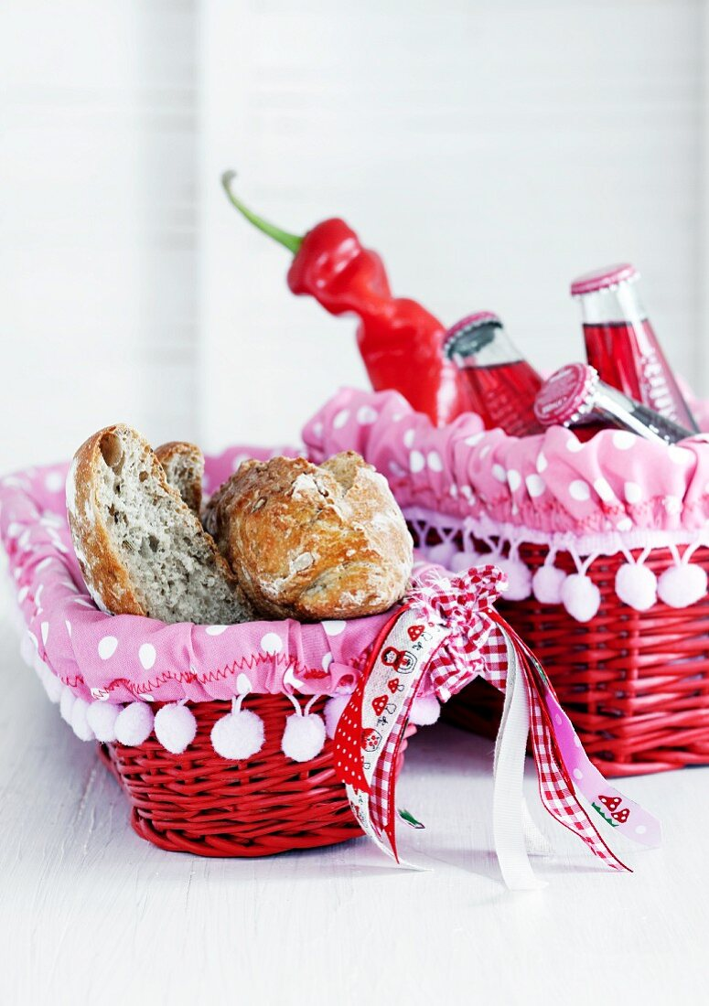 Red wicker baskets with lined with pink, polka dot fabric