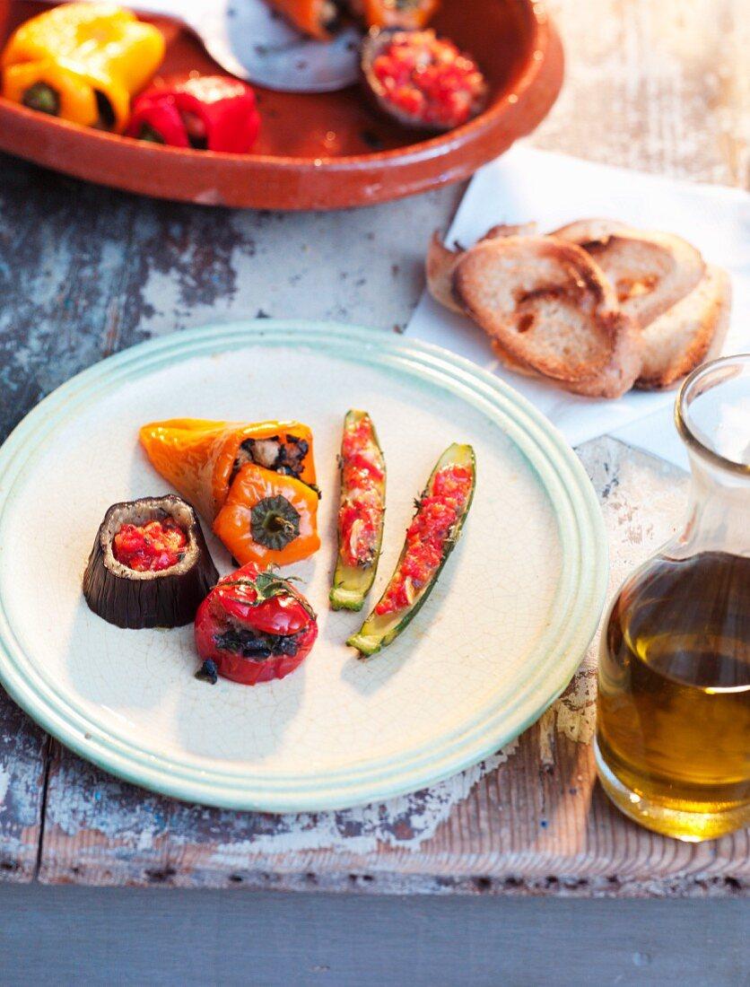 Stuffed vegetables, olive oil, baguette