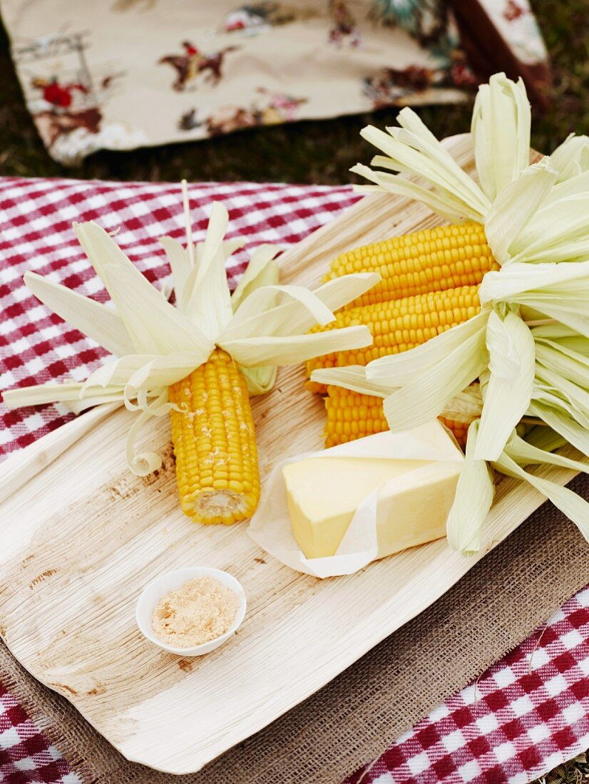 Grilled corn on the cob with butter at a Cowboy and Indian party