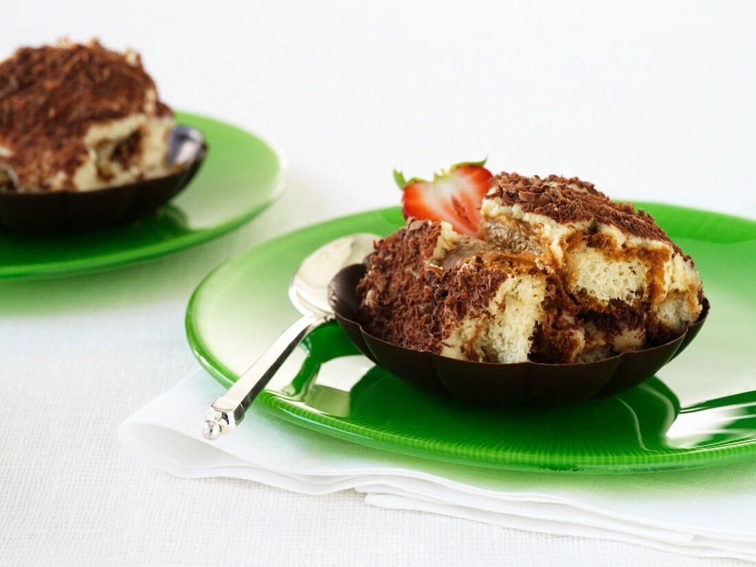 Tiramisu with strawberries in a chocolate shell