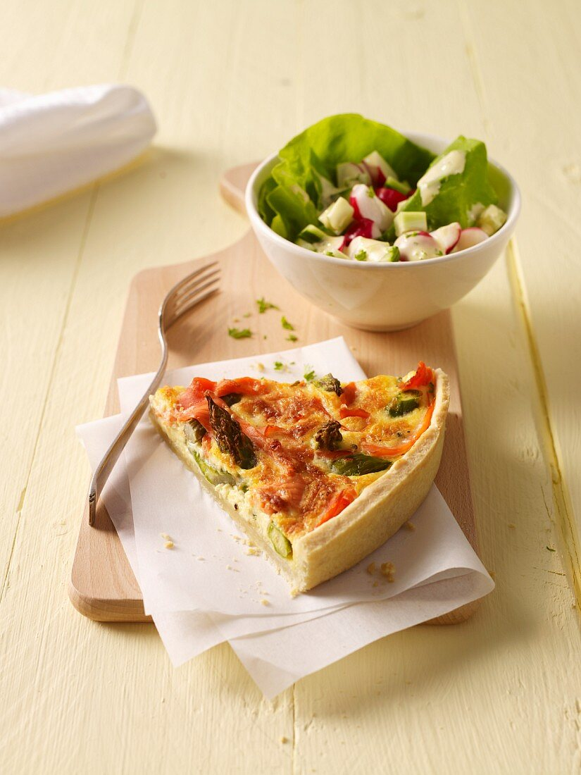 A slice of asparagus-leek quiche and salad