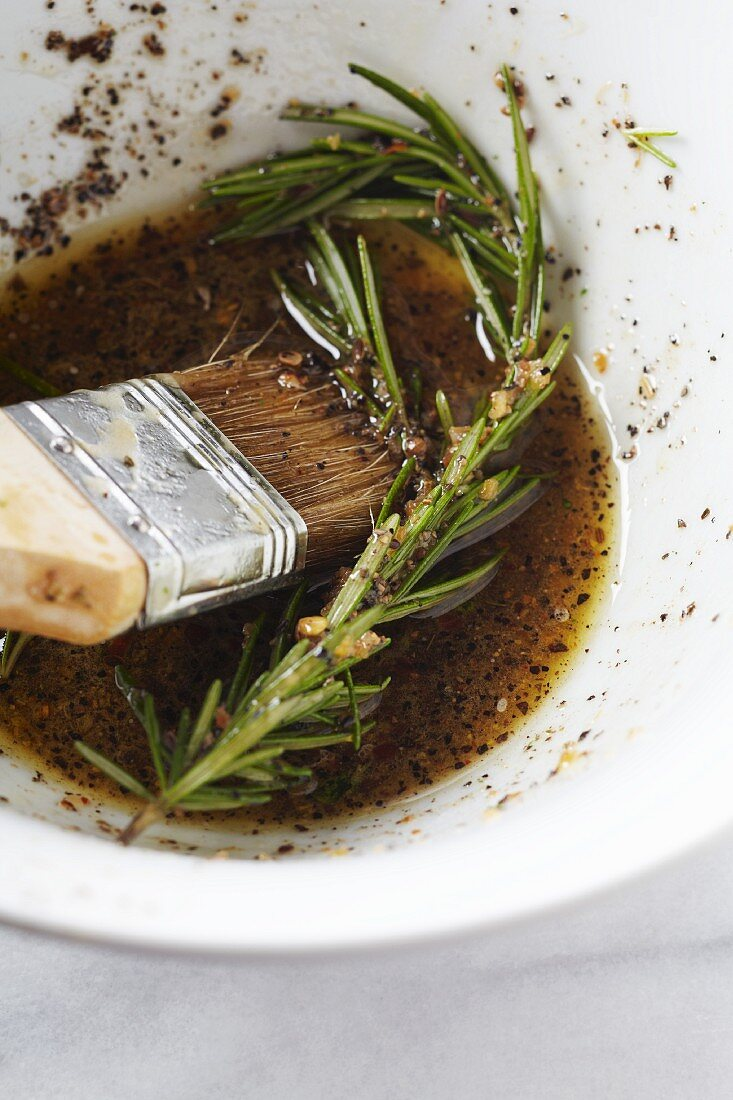 Rosemary Marinade in a Bowl with a Basting Brush