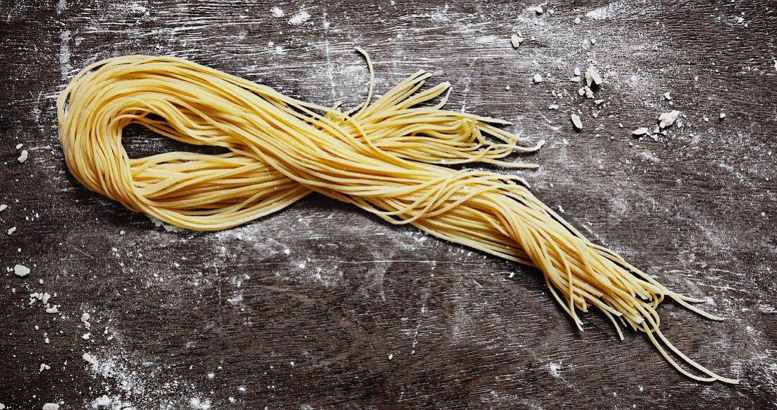 Home-made spaghetti on rustic board