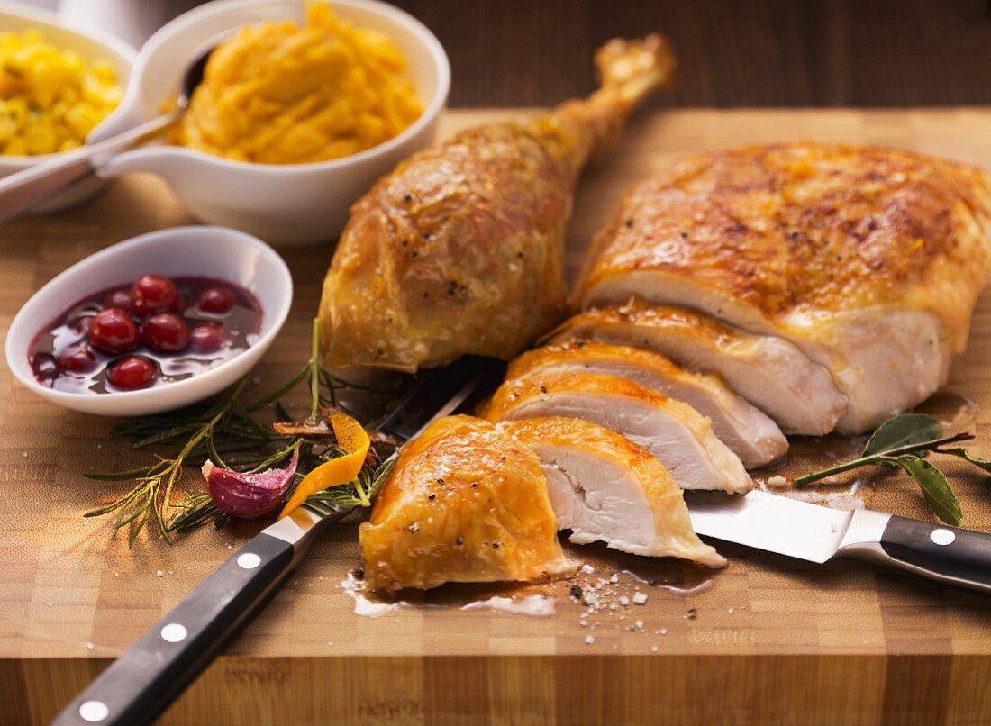 Sliced roast turkey with cranberry sauce and sweet potato puree