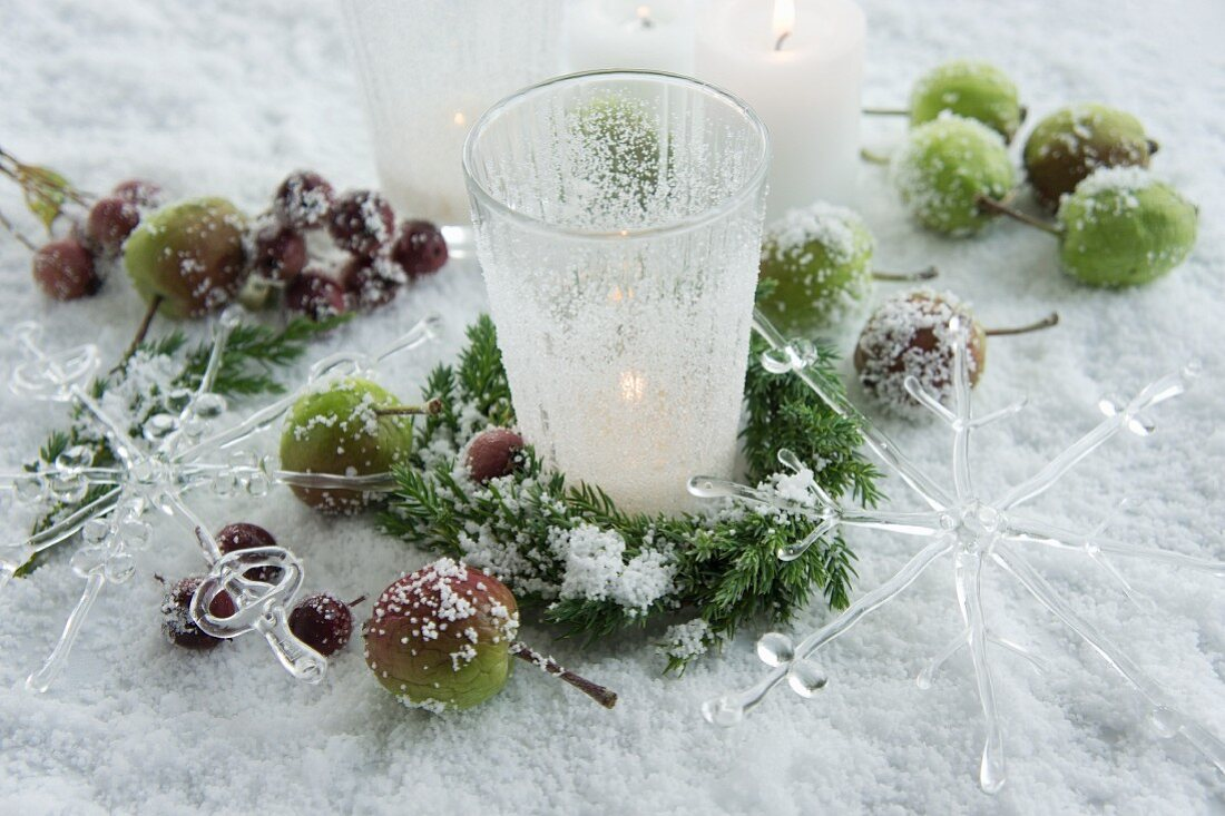 Frosted tea light holders and apples in the snow
