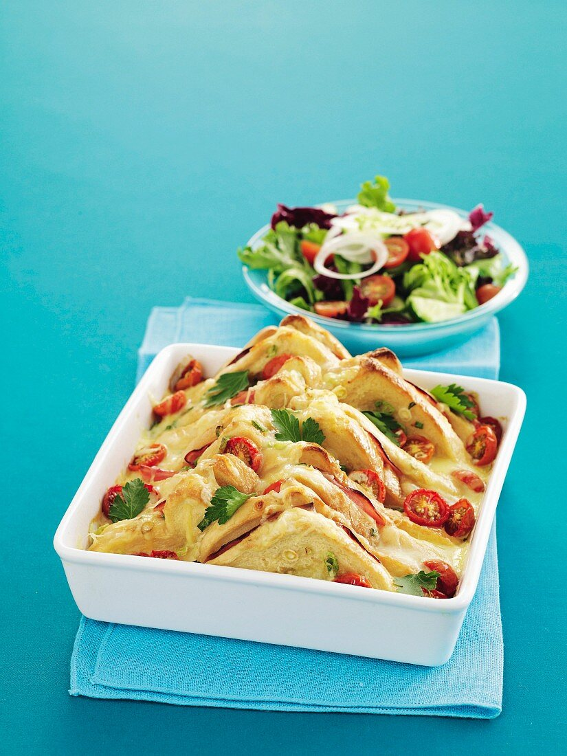 Bread casserole with ham, cheese and tomatoes