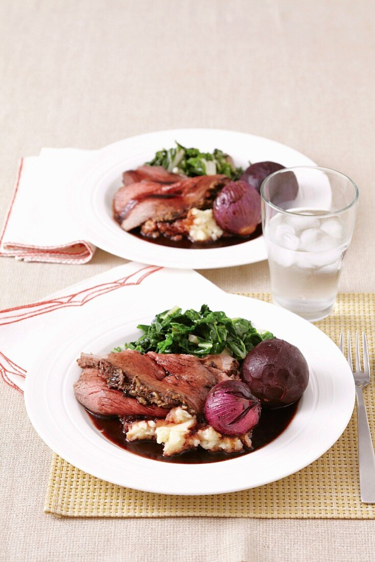 Beef in balsamic vinegar sauce with caramelised red onions