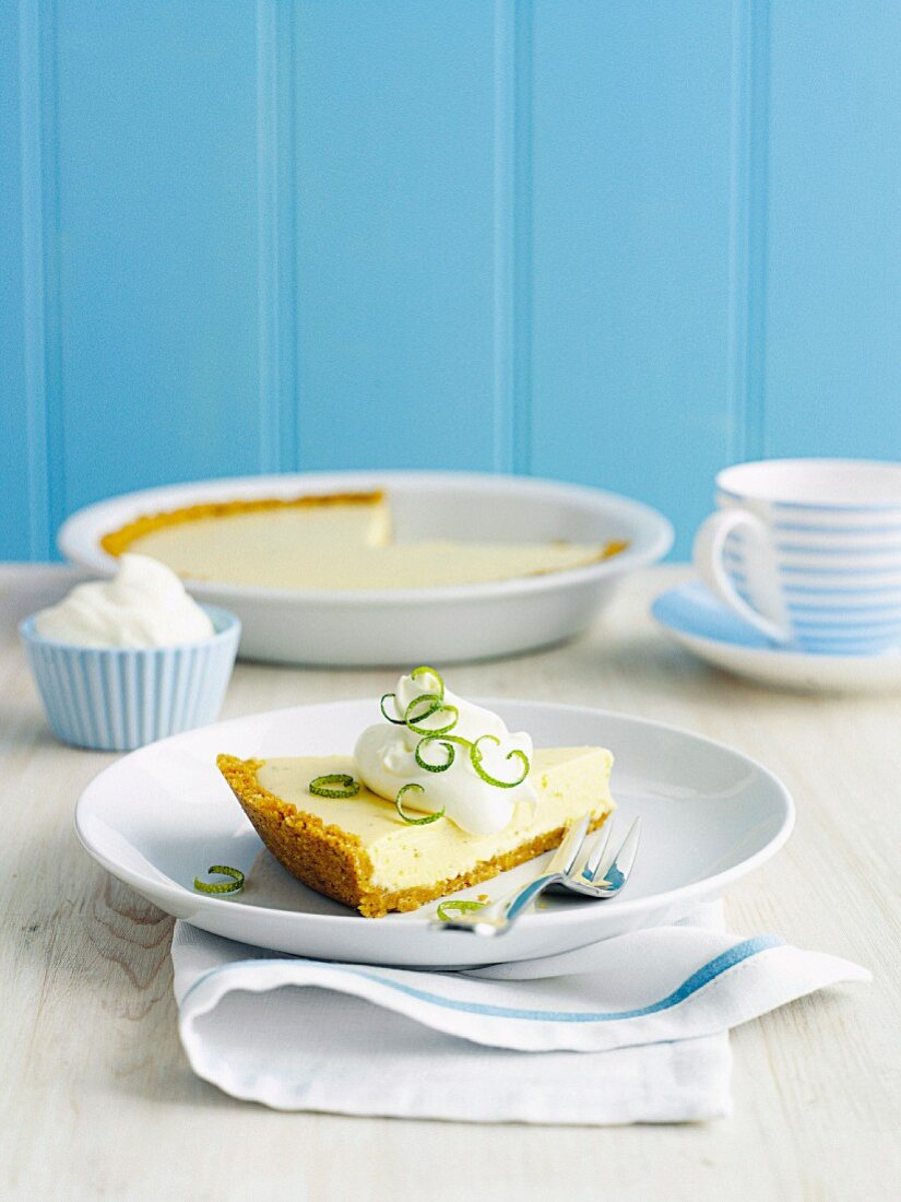 A slice of Key Lime Pie with cream
